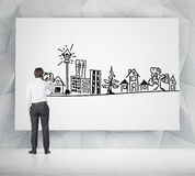 Businessman drawing real estate Stock Photo
