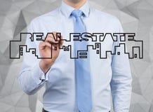 Businessman drawing real estate Stock Photos