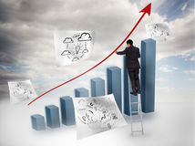 Businessman drawing a red arrow over a chart Stock Image