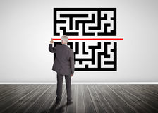 Businessman drawing red line through quick response code. On a wall Stock Image