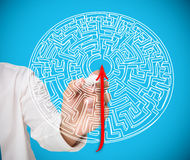 Businessman drawing red line to centre of maze Royalty Free Stock Photos