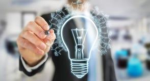 Businessman drawing renewable eco lightbulb sketch Stock Photos