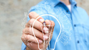 Businessman drawing renewable eco lightbulb sketch Royalty Free Stock Photo