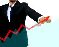 Businessman drawing a rising arrow Royalty Free Stock Image