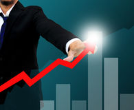 Businessman drawing a rising arrow Royalty Free Stock Photo