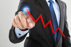 Businessman drawing a rising arrow. Representing business growth royalty free stock photos