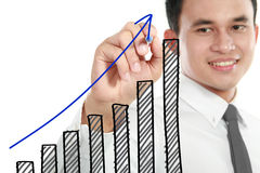 Businessman drawing a rising diagram. Representing business growth royalty free stock photos