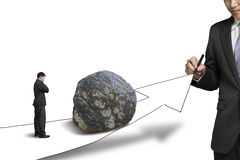 Businessman drawing road with growth arrow and large rock on the. Way the other standing toward the rock and thinking Royalty Free Stock Images