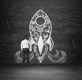 Businessman drawing rocket Stock Image