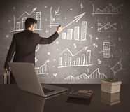 Businessman drawing sales charts on wall Royalty Free Stock Photography
