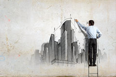 Businessman drawing sketch Royalty Free Stock Image