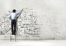 Businessman drawing sketch Stock Image