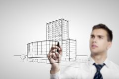 Businessman  drawing skyscraper Stock Image