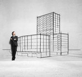 Businessman and drawing skyscraper Royalty Free Stock Images