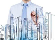 Businessman drawing skyscraper Stock Photo