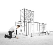 Businessman drawing skyscraper Stock Photography