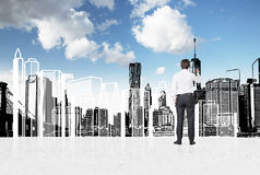 Businessman drawing skyscraper Royalty Free Stock Images