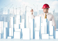 Businessman drawing skyscrapers Royalty Free Stock Image