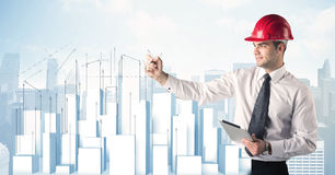 Businessman drawing skyscrapers Stock Photo