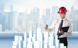 Businessman drawing skyscrapers Royalty Free Stock Photo