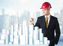 Businessman drawing skyscrapers Stock Image