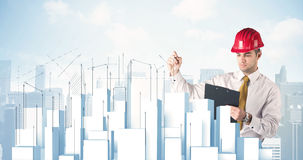 Businessman drawing skyscrapers Stock Images