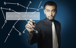 Businessman drawing social network Stock Photography