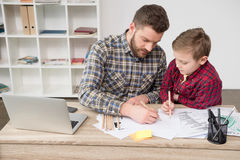 Businessman drawing with son Stock Photography