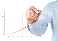 Businessman drawing a stock chart Stock Photos
