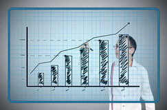 Businessman drawing stock chart Stock Images