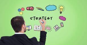 Businessman drawing strategy graphics. Digital composite of Businessman drawing strategy graphics Royalty Free Stock Photography