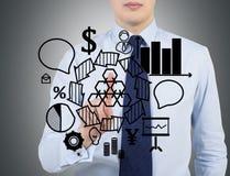 Businessman drawing success scheme Stock Photo