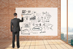 Businessman drawing success sketch Royalty Free Stock Images