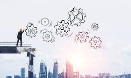 Businessman drawing teamwork conceptual scheme. royalty free stock photography