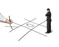 Businessman drawing Tic-Tac-Toe game on white background, anothe. Businessman hold pen drawing Tic-Tac-Toe game on white background, another is thinking Stock Photos