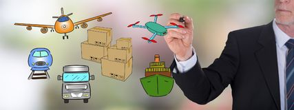 Transportation concept drawn by a businessman. Businessman drawing a transportation concept Royalty Free Stock Photos
