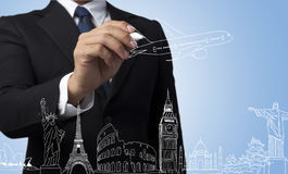 Businessman drawing travel around the world Stock Photos