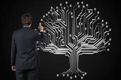 Businessman drawing tree Stock Photos
