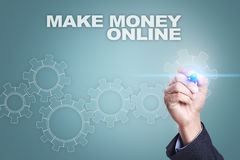 Businessman drawing on virtual screen. make money online concept stock images
