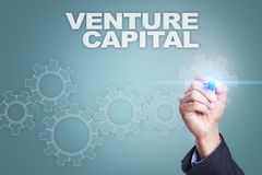Businessman drawing on virtual screen. venture capital concept.  Stock Image