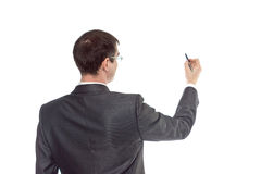 Businessman drawing on a white background. Isolated image Stock Photos