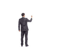 Businessman drawing on a white background. Isolated image Royalty Free Stock Photo