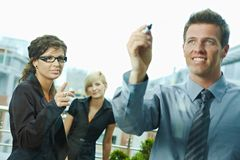 Businessman drawing on window Royalty Free Stock Photography