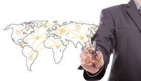 Businessman drawing a world map Royalty Free Stock Photography