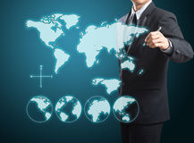 Businessman drawing the world map. On screen Royalty Free Stock Images
