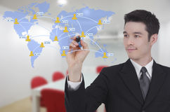 Businessman drawing world map and social network w Stock Images