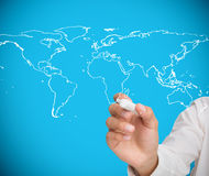 Businessman drawing world map Stock Image