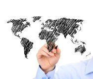 Businessman drawing the world map Stock Images