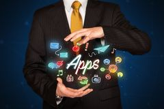 Businessman holding apps Royalty Free Stock Photography