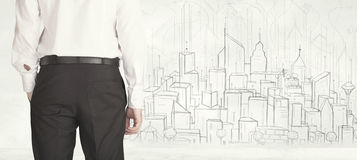 Businessman with drawn city view Royalty Free Stock Images